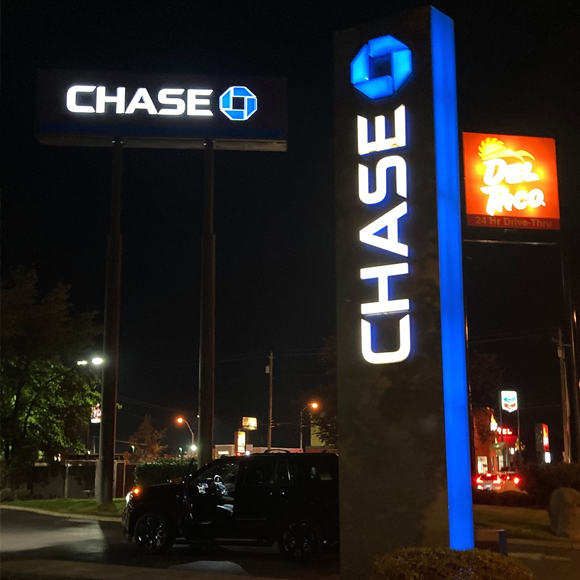 Chase Bank and Del Taco lit signs