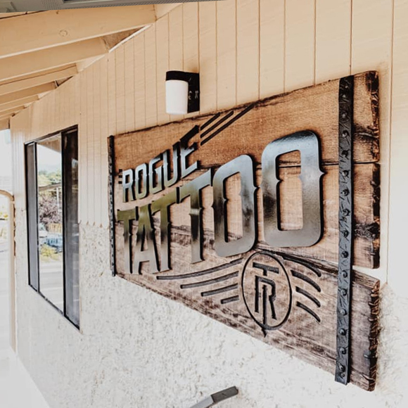 Rogue Tattoo building sign - burnt reclaimed wood and metal features