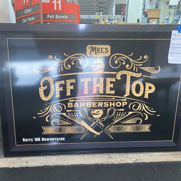 Off the Top Barbershop - building sign with gold accents